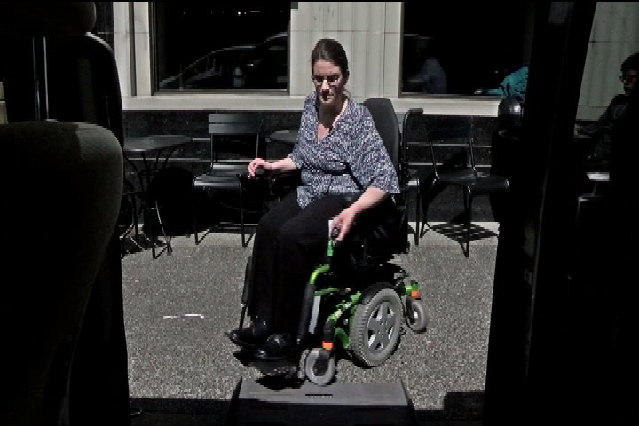 Langford woman with multiple sclerosis says officer mistook steering wheel controls for cell phone, and fined her.
