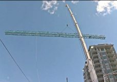 Mammoth crane dismantled in downtown Victoria