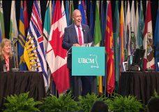 Premier John Horgan cracks jokes, promises help at UBCM