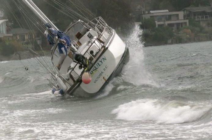 Strong winds strand sailboat on Cadboro Bay beach