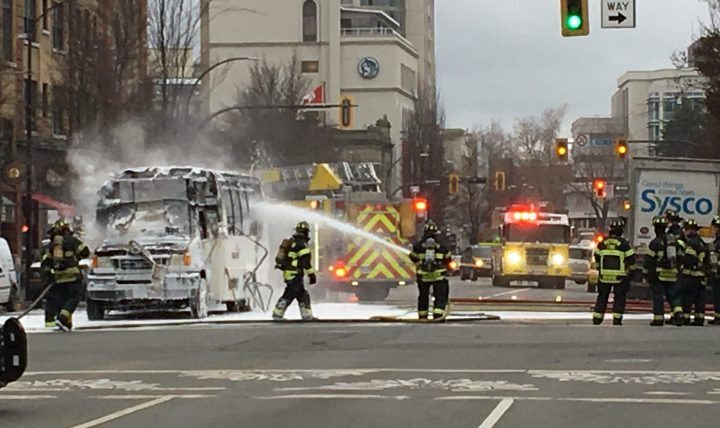 A Wilson Transportation bus on fire at Fort Street and Blanshard Street in Victoria Wednesday morning.