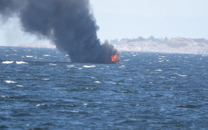 A boat catches fire off the coast of Nanaimo on Sept. 27, 2018, as seen from Neck Point Park. Photo Credit: Gary Magnusson.