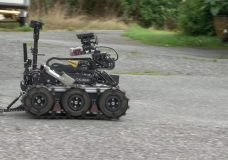 A robot is used to examine the area where a mail bomb went off in Pot Alice on Sept. 11, 2018.