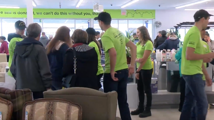 Employees throughout the store helped customers with any questions