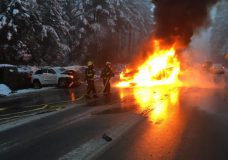 Firefighters work to put out a fire to one of the vehicles involved in a crash Tuesday morning. Photo courtesy Nick Labadie/BC Hydro.