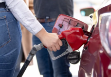 A woman fills up her car at a Metro Vancouver gas station (Evan Mitsui/CBC)