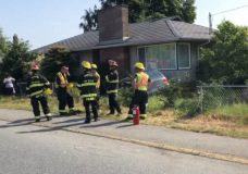 Nanaimo RCMP and fire on scene of a two-vehicle collision on Second Street at Wakesiah Avenue, where one car ended up slamming into a house.