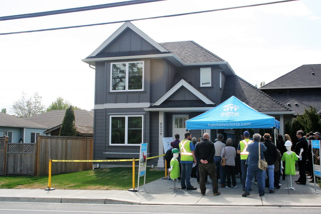 Family officially receives keys to new Central Saanich home from Habitat for Humanity Victoria