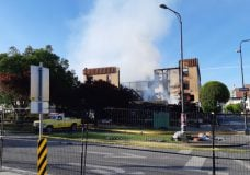 Flames still visible more than 24 hours after blaze started that gutted Victoria Plaza Hotel