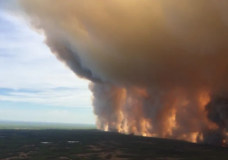 The massive Chuckegg Creek fire burning near the town of High Level, Alta., on Sunday, May 19. (Government of Alberta/CBC)