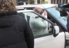 Tenessa Nikirk shielding her face near the Victoria courthouse on Jan. 27, 2020.