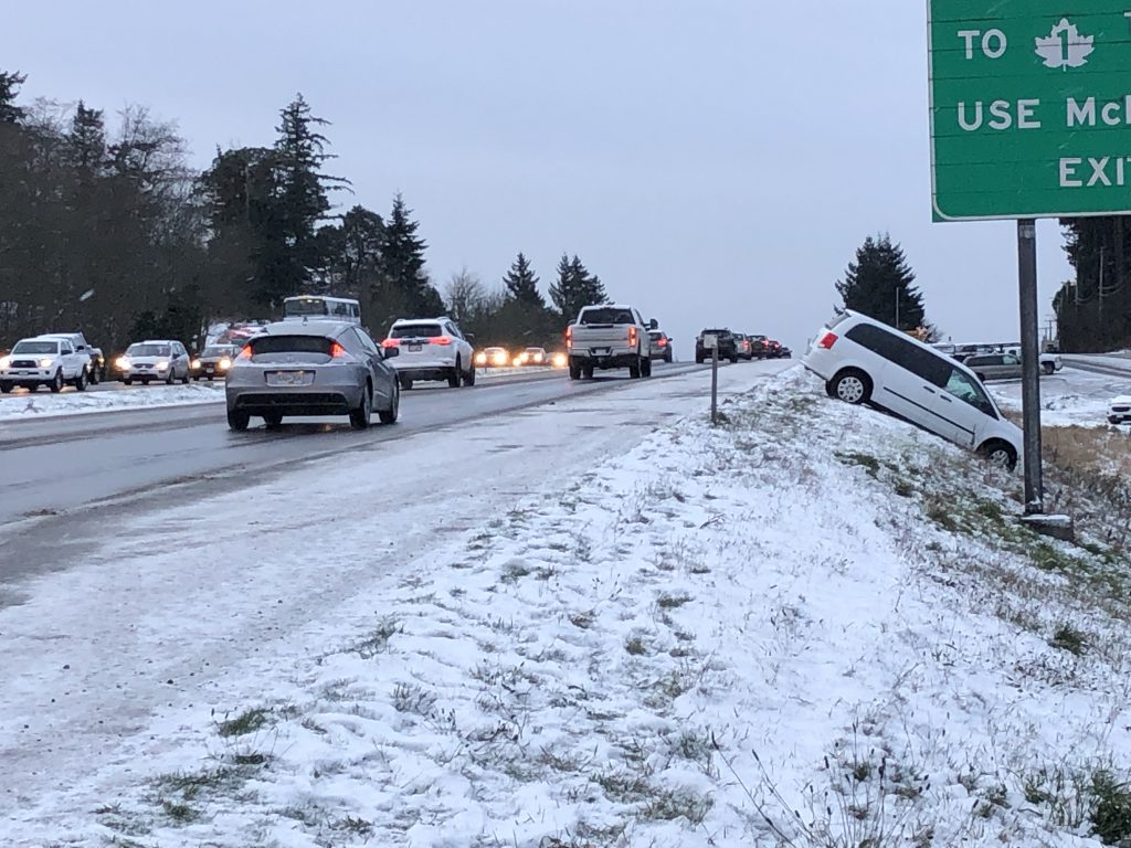 A car driven off the Pat Bay highway during snowy conditions
