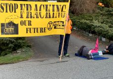 Three arrested for mischief after Extinction Rebellion blocks driveway at B.C. premier's home