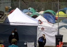 Tents are seen at the temporary homeless encampment at Topaz Park on April 23, 2020.