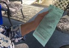 Penny Hamilton holds her speeding ticket in Nanaimo.