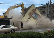 A pedestrian narrowly avoids falling building material during a demolition in Esquimalt on May 22, 2020. Photo courtesy of Leah DeForrest.