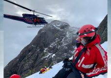A trio of hikers had just summited the 1800m mountain Saturday afternoon when the man fell over 20 metres suffering serious injuries