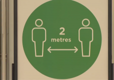 A sign reminding people to stay two metres apart from one another.