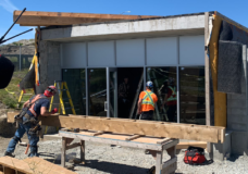 Construction crews work on the new gender neutral washroom at the Clover Point Pump Station. Once completed, it will also have a public outdoor shower.