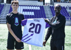 Sean Young and Pacific FC coach Pa-Modou Kah.