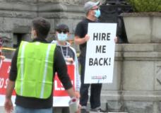 Hotel workers strike outside the B.C. legislature.