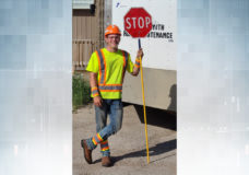Daniel Odger-Stedman, the dancing traffic flagger from Victoria holding a stop sign in his construction flagging gear