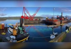 Divers restart salvage operation on sunken barge in Port McNeill