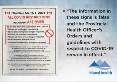 'Disgusted': Posters saying COVID-19 restrictions have ended appear all over Vancouver Island