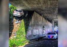 Man fleeing police crashes, wedges Maserati under freeway