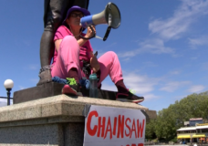Woman chains herself to downtown Victoria statue in solidarity with Fairy Creek protesters