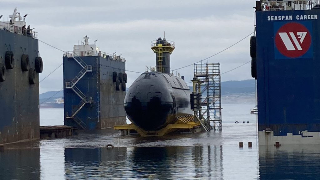 HMCS Corner Brook barged to Ogden Point as it prepares to return to the water