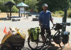 CHEK Upside: Victoria man and his dog cycling to Arctic to help animals in need