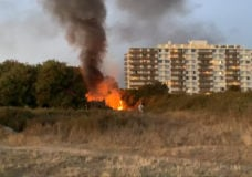 Fire breaks out in dry brush near encampment along Dallas Road