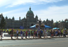 Man arrested for assault with 'hot liquid' at Victoria anti-vaccine card protest: police